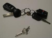 2 sets of car keys and a house key