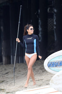 Eva Longoria in white bikini bottoms and sunglasses