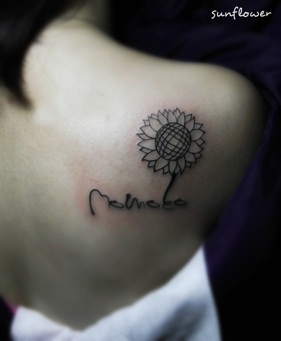 A concise sunflower tattoo on the back