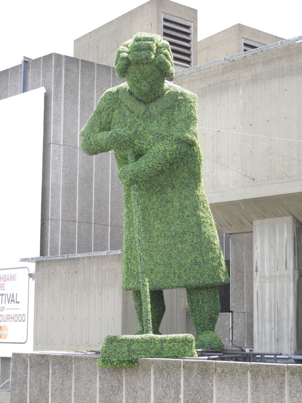 Giant topiary figure sweeping Southbank