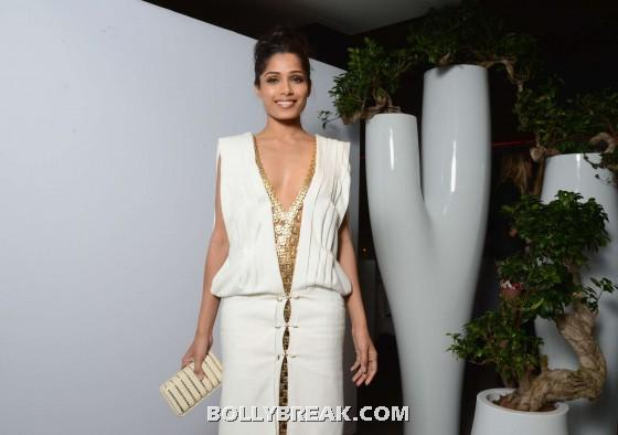 Frieda pinto cannes - Freida Pinto in white dress at L'Oreal 15th Anniversary Dinner