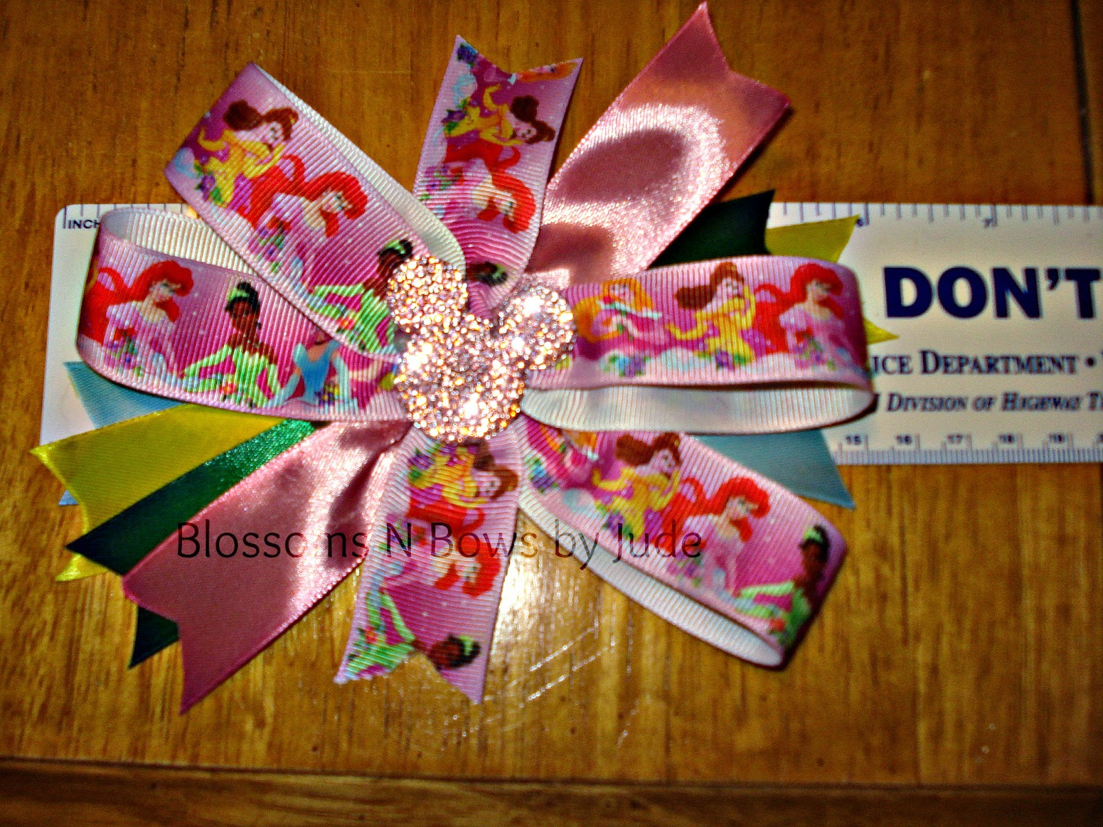 http://www.ebay.com/itm/Disney-Princess-Hair-Bow-U-choose-headband-alligator-clip-Free-Shipping-/151273266668?pt=US_Girls_Accessories&hash=item233896ddec