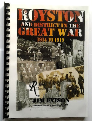 A comb bound book - glossy laminate cover with the title (see my text) and a composite image of WW1 soldiers, a crowd scene (lots of flat caps) and some school staff I think