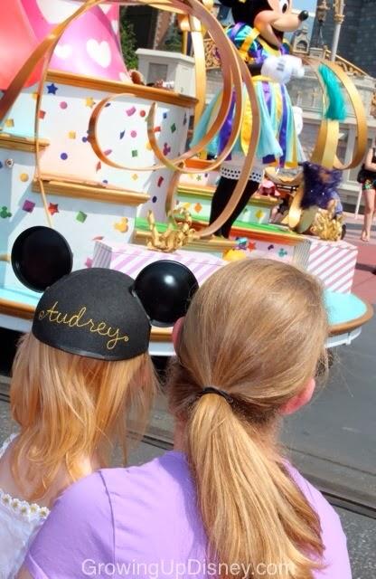 Mother and Daughter enjoying a Disney parade