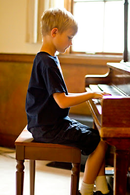 Xander playing at the piano recital