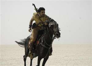 ramacharan riding horse magadheera image