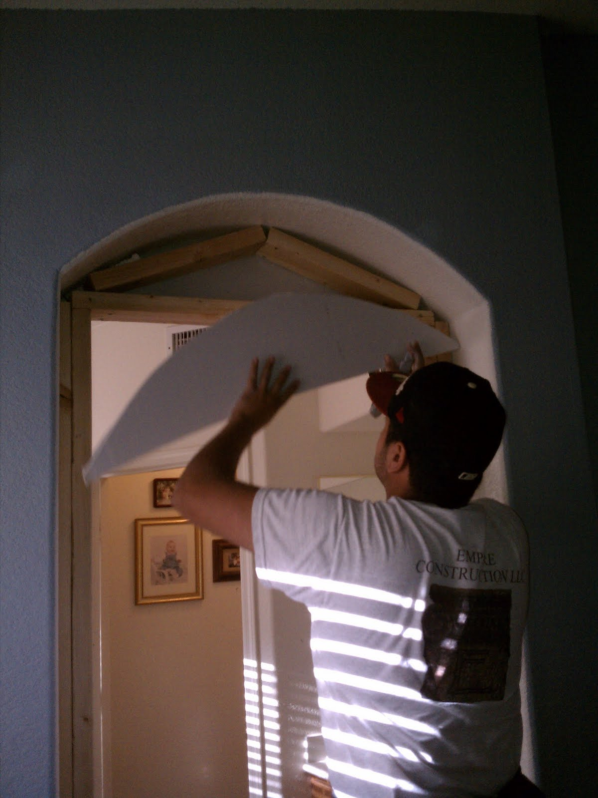 Cutting The Top Arch Semi Circle Crescent Out Of Drywall. Tool: Razor Knife.