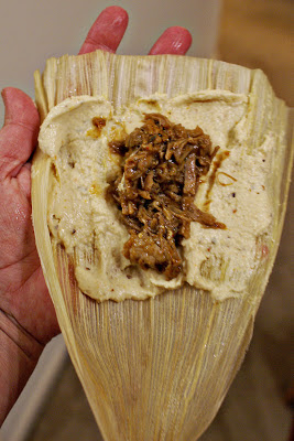 Rolling a tamal
