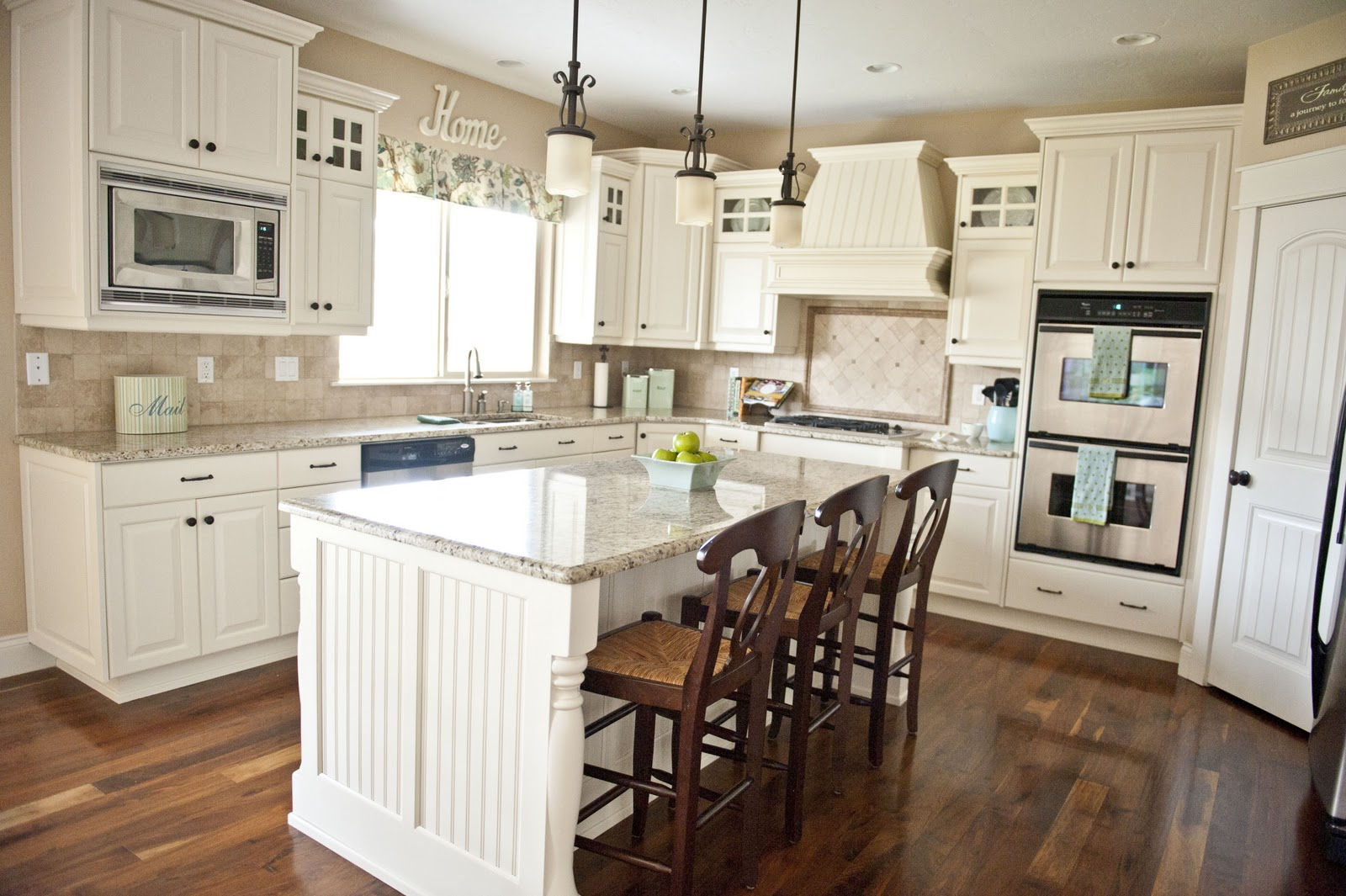 Guest post sita from the family room design studio for Painting wooden kitchen cabinets white