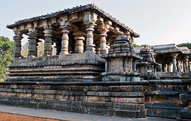 Friezes on the base of the Nandi Mantapa 1, beside it is the Nandi Mantapa 2