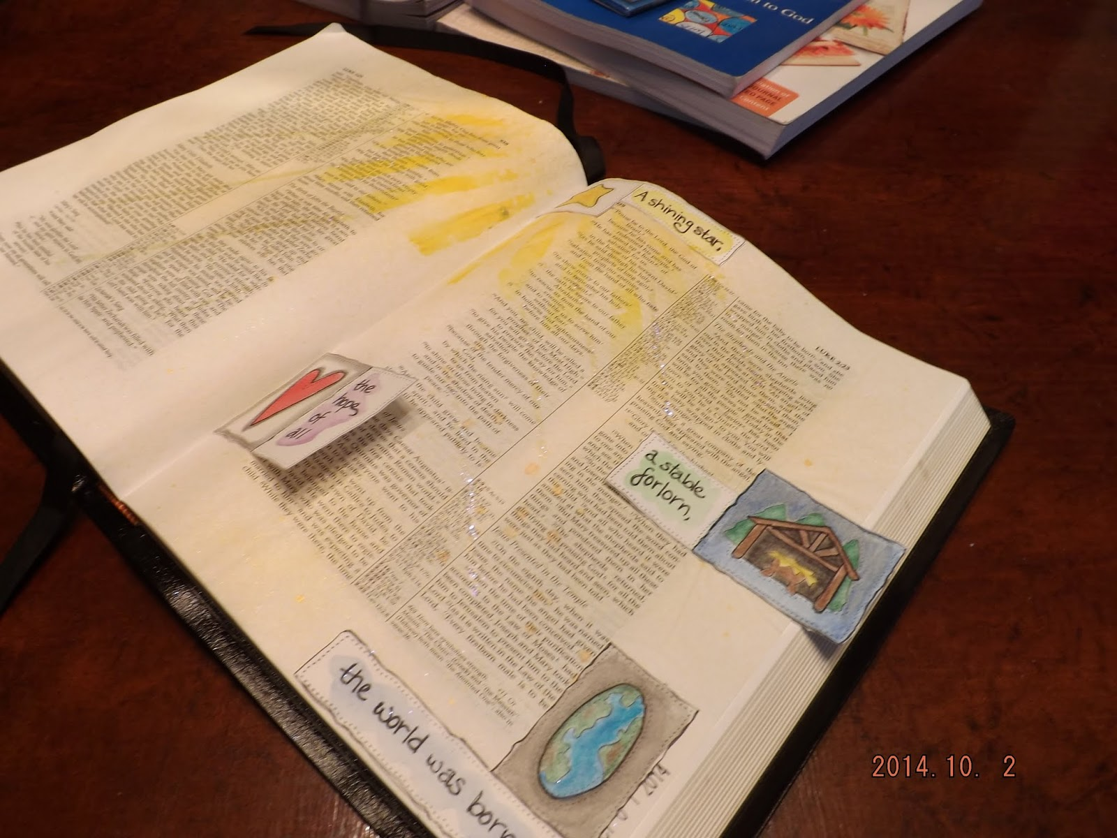 Luke 1 and 2 in art journaling Bible with stamped tip outs.