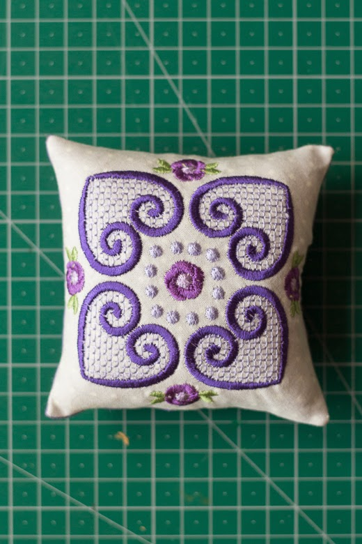 Purple embroidered pincushion
