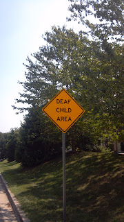 deaf child in area sign