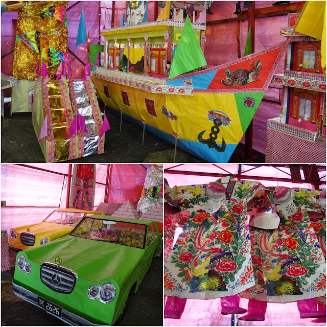Paper formed miniature boat, clothes and cars burning for offering to the ancestors and visiting spirits during Hungry Ghost Festival in Kuala Lumpur, Malaysia