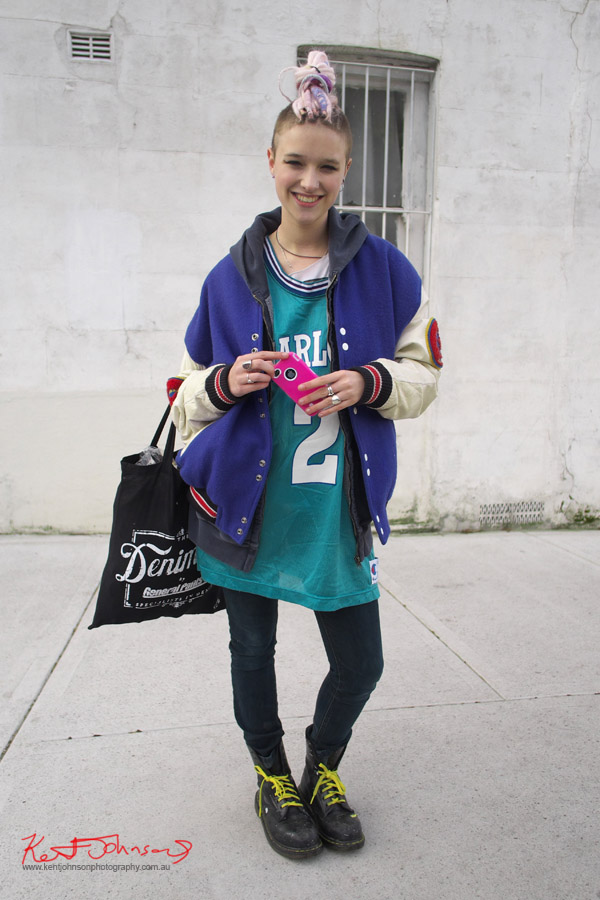 South Newtown Street Style Fashion, Pink iPhone, College Varsity Jacket, NFL Football Jersey, Black Doc Martin Boots, Cropped Hair with Pink Dreadlocks,
