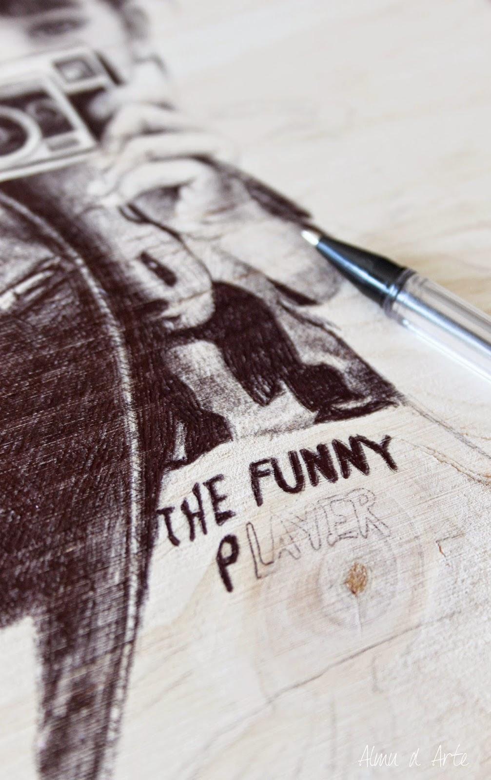 Dibujo a bolígrafo sobre tabla de madera