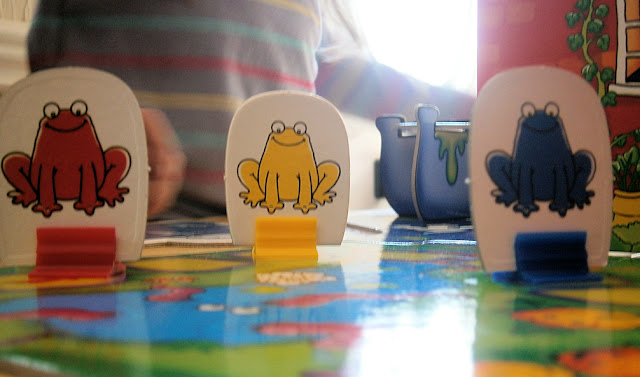 frog counter pieces in board game