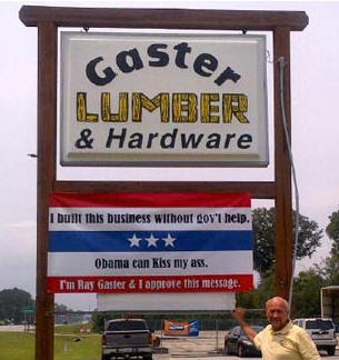 small business man sign telling obama to kiss his ass