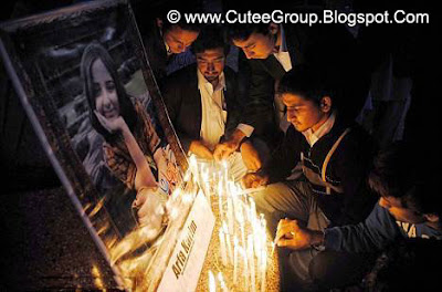 Memorial Youths light candles to pay homage to Arifa Karim during a ceremony in her memory held in Peshawar