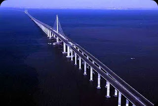 The marathon-length Qingdao Haiwan Bridge would easily span the English  Channel and is almost three miles longer than the previous record-holder,  ...