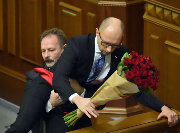 Ukraine's Prime Minister gets crotch-lifted off the parliament floor