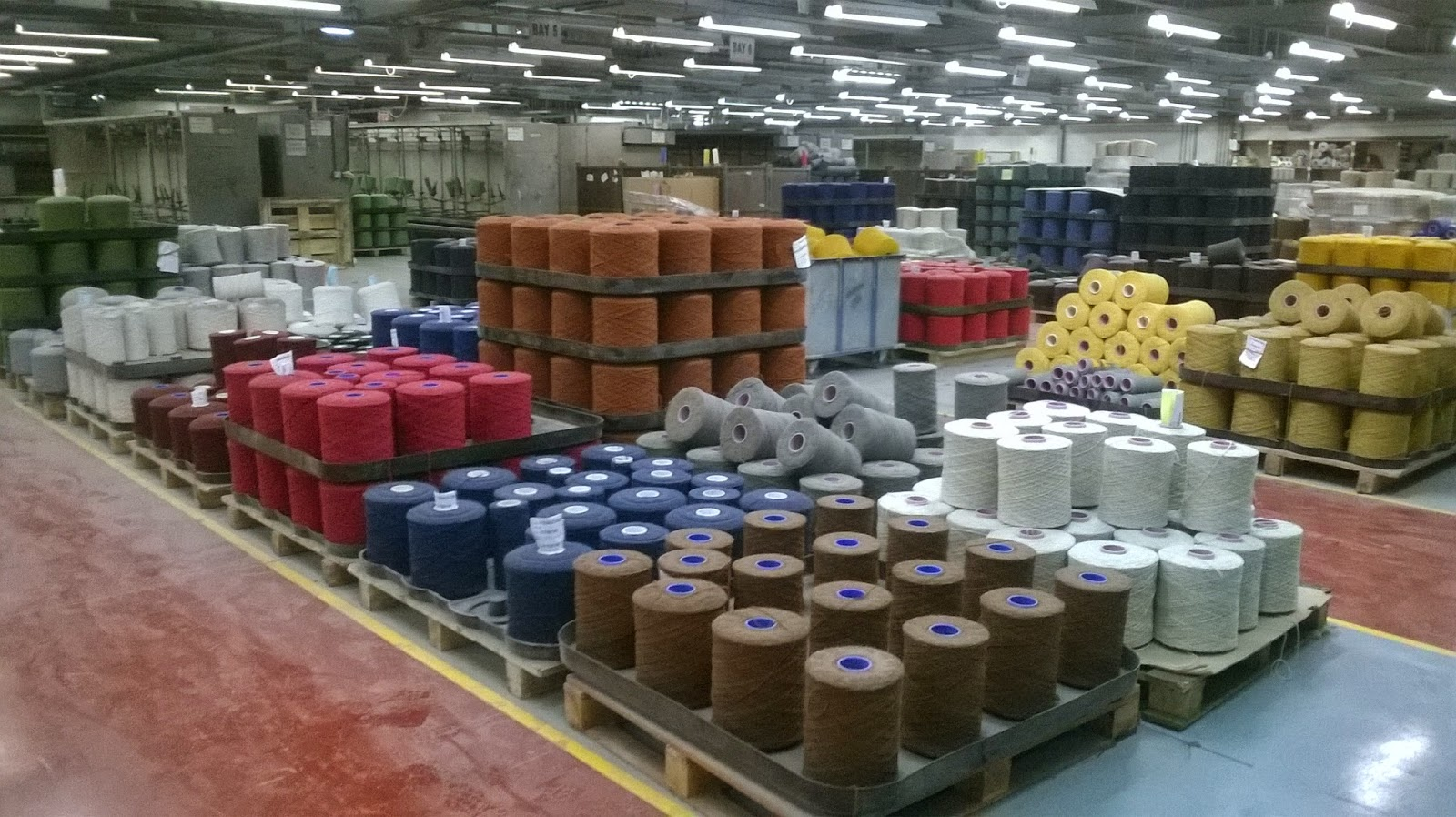 Pre dyed wool spools ready for the looms at the Brinton's factory