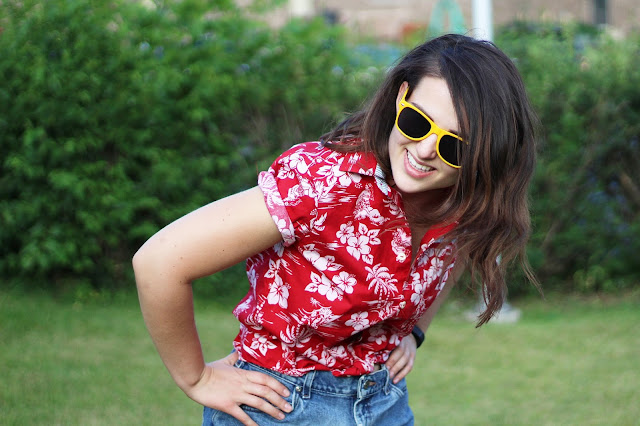 brunette girl modeling crop top with yellow sunglasses and jean shorts handmade and hand sewn