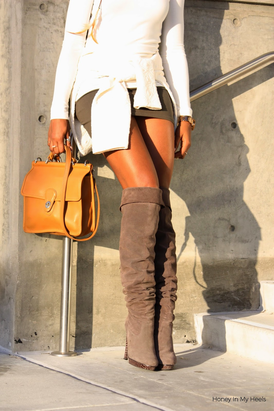 Wearing Coach purse Bakers over the knee boots Nixon rose gold watch