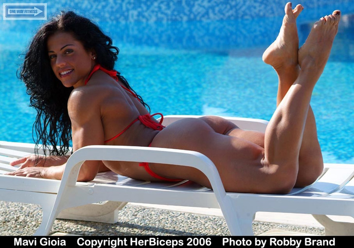 Mavi Gioia Models Her Great Butt And Muscular Legs In A Red Bikini