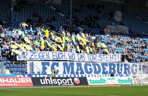 A group of Magdeburg supporters show their players where the goal is