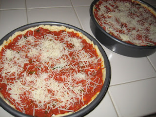 Adding Tomato Sauce on a Chicago Deep Dish Pizza