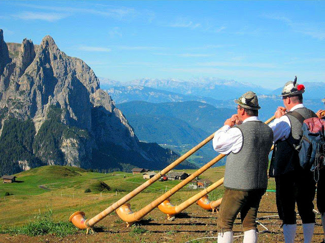 Dolomites quartet play their Alphorns or Alpenhorns, a tradition that dates back to the 16th century if not earlier when they were used to call the cattle back to the barns and for communication. Today, many Alpine locals keep the tradition alive by performing in concerts around the region and the world.