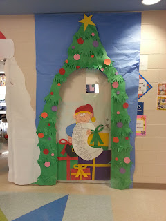 Second grade nest it 39 s beginning to look a lot like christmas for Elf door ideas