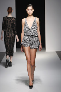 A model wearing a black and white playsuit on the Devastee catwalk