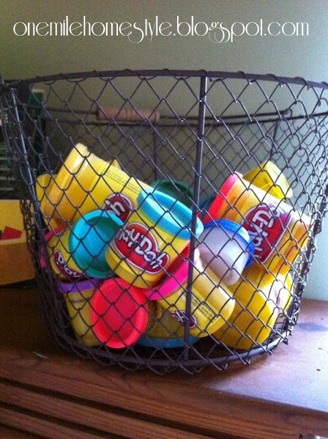Play-doh stored in a wire basket