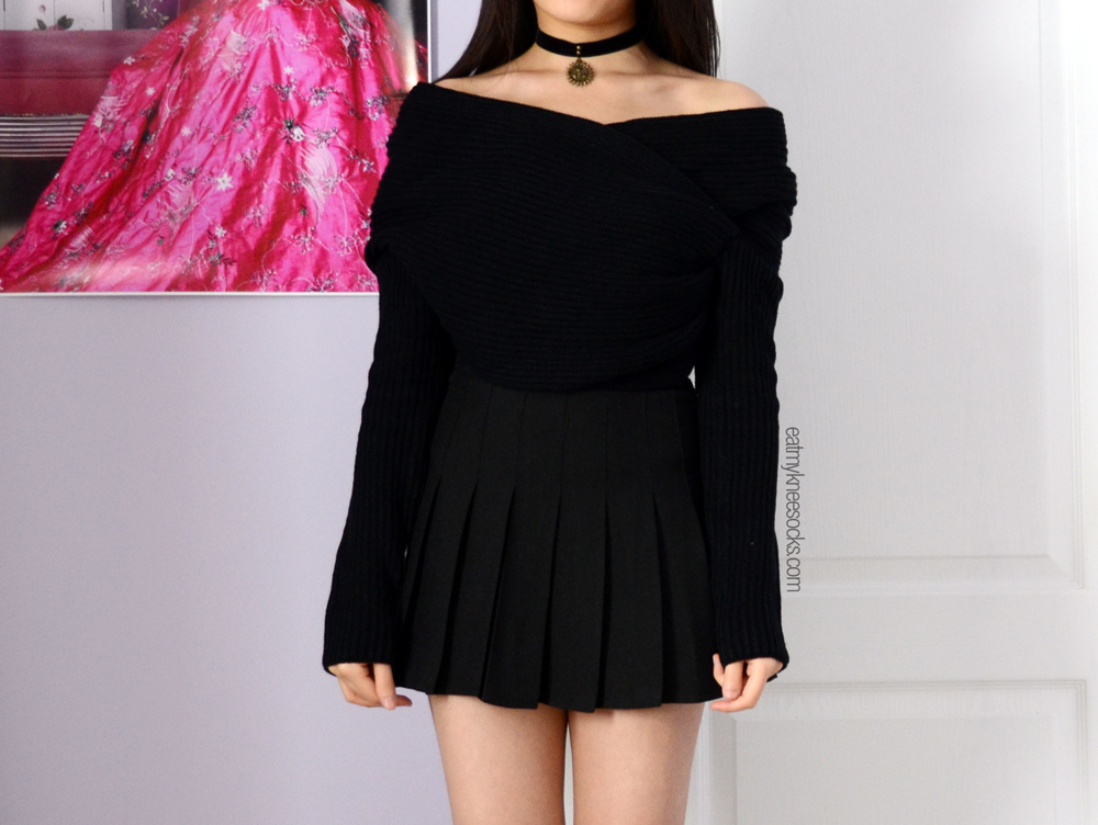 The off-shoulder wrap style asymmetric cropped sweater from JollyChic!