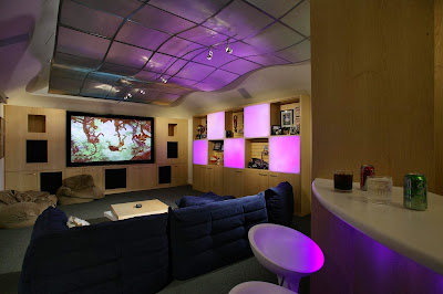 contemporary entertainment area with groovy ceiling attractive entertainment wall and racks as well as comfortable floor mounted sofa
