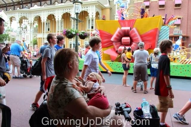 child napping during parade at walt disney world