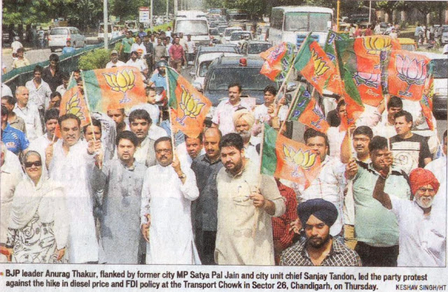 BJP leader Anurag Thakur, flanked by former city MP Satya Pal Jain and city unit chief Sanjay Tandon, led the party protest against the hike in diesel price and FDI policy at the Transport Chowk in Sector 26, Chandigarh, on Thursday.