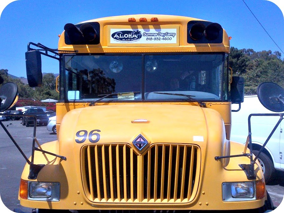 Picture of an Aloha Beach Camp summer camp school bus.