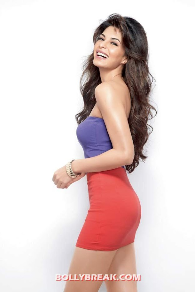 Jacqueline Fernandez Hot Legs Show in Red Short Dress - Long hair - Jacqueline Fernandez Hot Photoshoot for Women's Health India