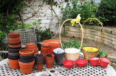 Collection of plant pots on the garden table