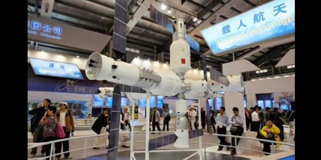 Visitors to the Airshow China exhibition look at a model of the Tiangong-1 space station. Photograph: Ranwen/Imaginechina
