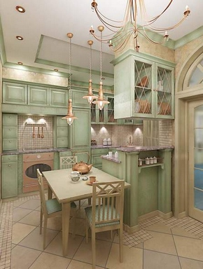 [Green and ivory french country style kitchen with bronze-colored metal light fixtures]