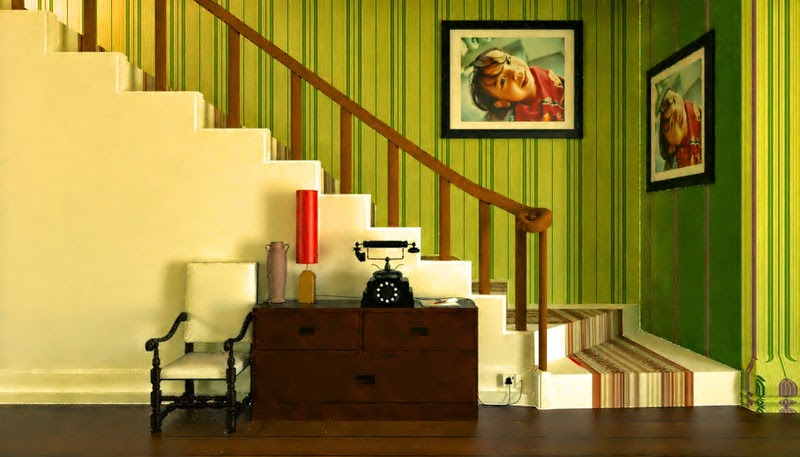 a yellow staircase, and a green wall