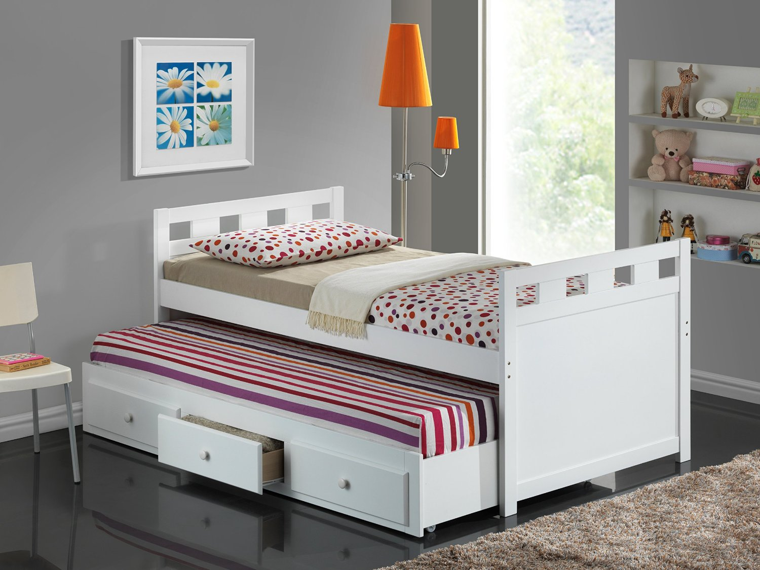 Twin bed with pull out slide out trundle bed underneath for Best beds for small rooms