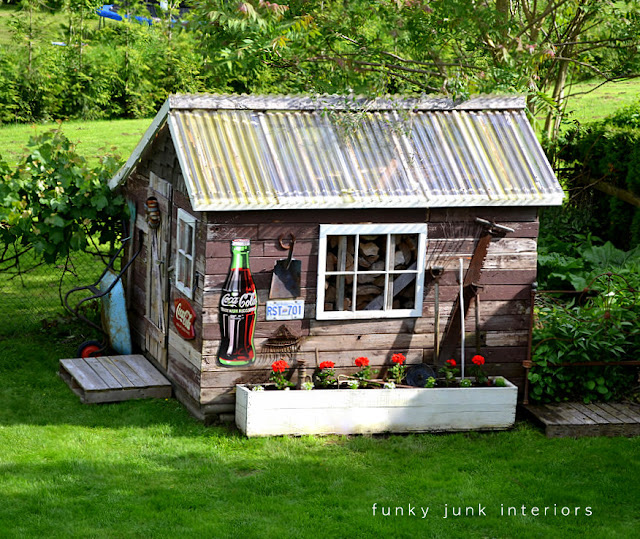 Rustic shed with grapevines / part of summer garden reveal on FunkyJunkInteriors.net