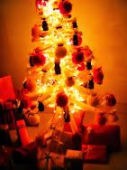 Árvore de Natal com as prendas
