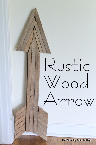 Use reclaimed wood sticks to make this extra large rustic wood arrow for your home today.