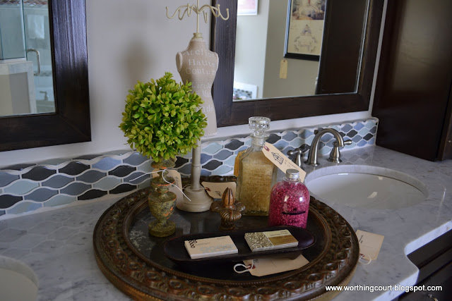 bathroom vignette on a round mirror via Worthing Court blog